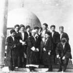 Muzaffer Effendi, ra, and his beloved dervishes who traveled with him to the Holy Land. Effendi is standing at the Dome of the Rock, the place from which Prophet Muhammad, saws, ascended through the seven heavens and entered the Divine Presence closer than two bow lengths. Effendi and his dervishes seem to be poised to ascend also. Effendi's gaze soars. It is beautiful because Effendi blesses this holy ground with his heart and with the heart of his dervishes. It is not an act of claiming possession but rather an act of dedication for all humanity. A gesture pointing the way for humanity, to retun altogether to their Lord and Lover. Here, from the holy ground of your Heart you can ascend to your Beloved. Eid Mubarak! Fariha al Jerrahi